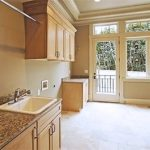 Bellevue custom home pantry and Laundry room - - Town Construction and Development